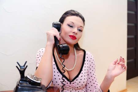 girl speaking on the phone retro photo