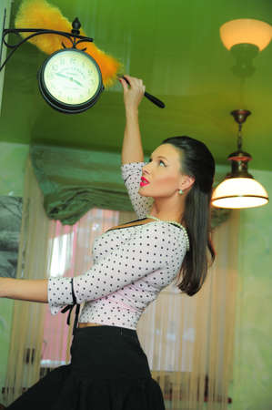 Woman dusting Stock Photo