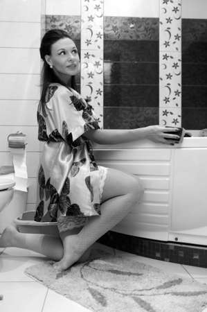 scrubbing up: the woman washes a bathroom