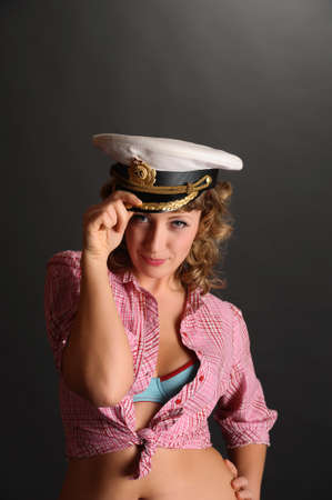 beautiful woman with a captain's cap Stock Photo - 9381480