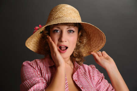 bin up girl in a straw hat photo