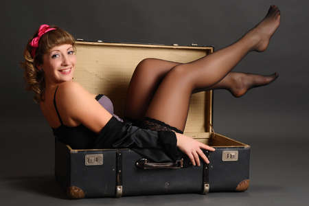 bin up girl in a suitcase photo