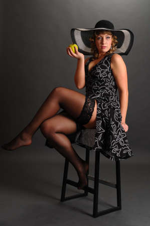 pin up girl with apple in hand Stock Photo - 9266801