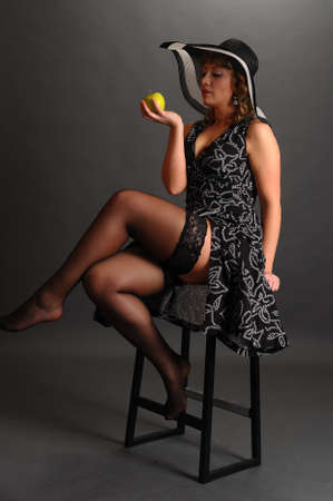 pin up girl with apple in hand photo