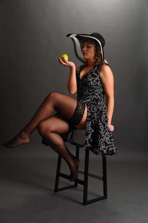 girl in a hat with an apple Stock Photo - 9266808
