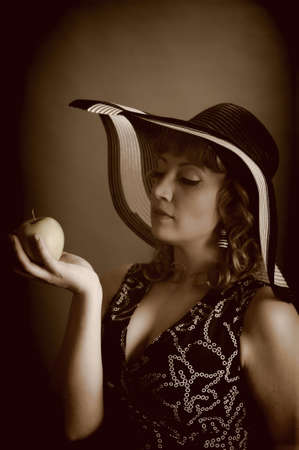girl in a hat with an apple Stock Photo - 9266799