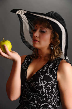 girl in a hat with an apple photo