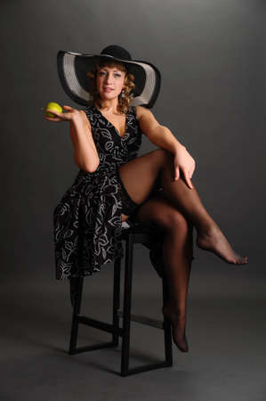 girl in a hat with an apple Stock Photo - 9266802