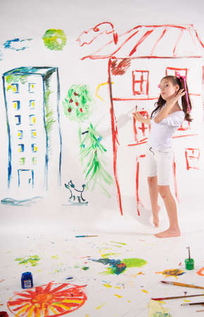 wall clouds: drawing a girl on the wall Stock Photo