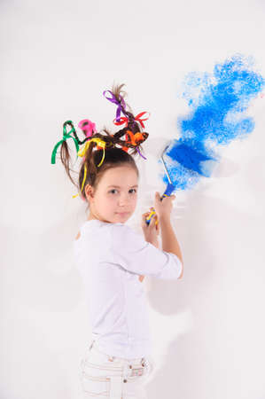 girl painting the walls in blue Stock Photo - 9359583