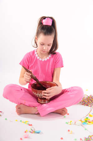 girl eating jam a large spoon photo