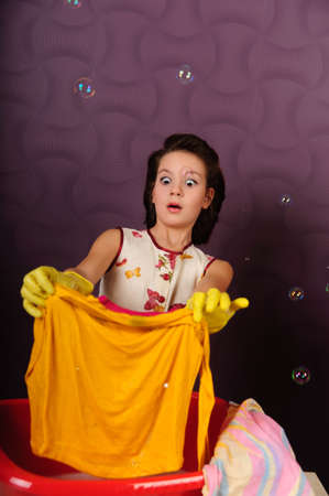 Girl wash clothes in a bucket Stock Photo - 9357840