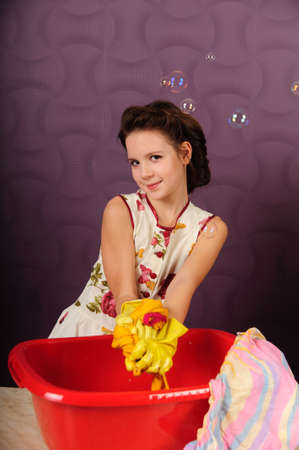 Girl wash clothes in a bucket Stock Photo - 9357845