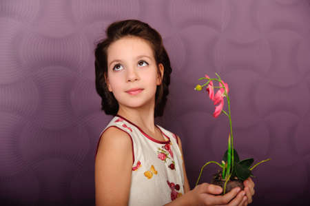 girl with an orchid  photo