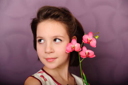 girl with an orchid  Stock Photo - 9358745