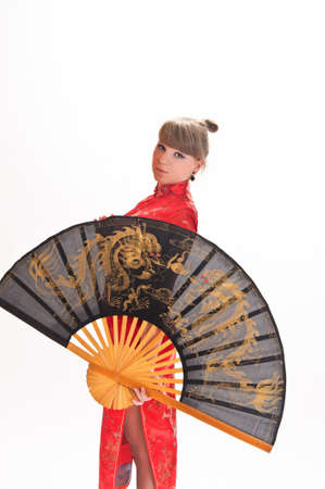 girl with a fan in a red Chinese dress photo