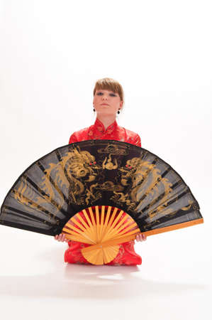 girl with a fan in a red Chinese dress Stock Photo - 9328283