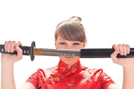 girl in a red dress with a katana Stock Photo - 9328124