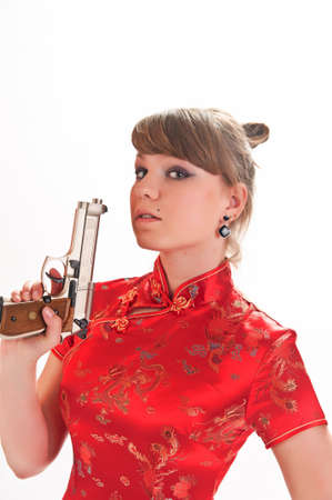 armed with a pistol girl in a red Chinese dress Stock Photo - 9328136