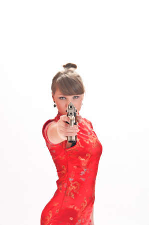 armed with a pistol girl in a red Chinese dress photo