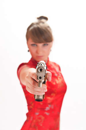 armed with a pistol girl in a red Chinese dress Stock Photo - 9328099