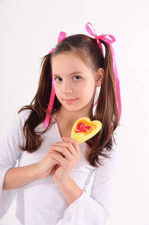 preteen girls: girl with big lollipop