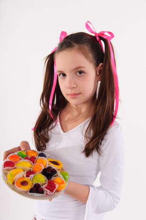 Girl eating cake photo