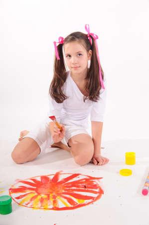 Schoolgirl painting  Stock Photo - 9357659