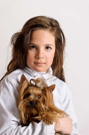 Girl with a Yorkshire terrier Stock Photo - 9403859