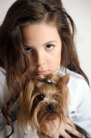 Girl with a Yorkshire terrier photo