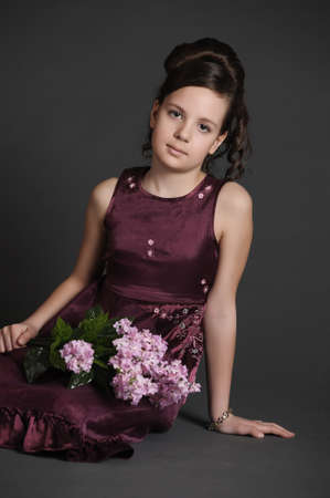 Girl with a branch of lilac Stock Photo - 9381113