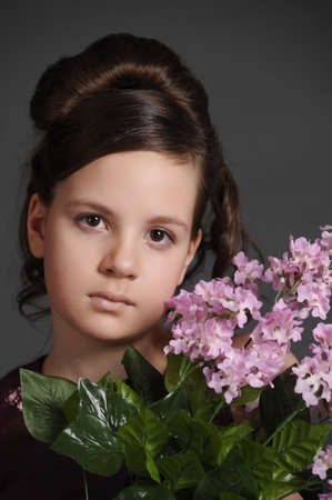 Girl with a branch of lilac photo