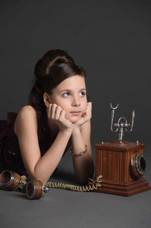 girl with a retro phone Stock Photo - 9723142