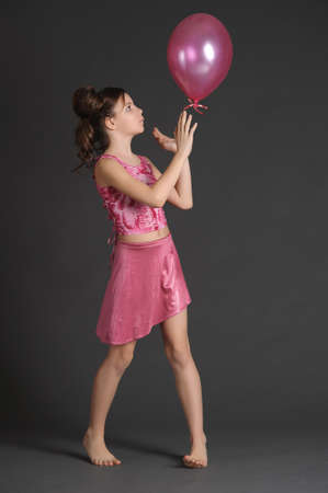 pretty s shiny: Girl in pink with pink ball Stock Photo