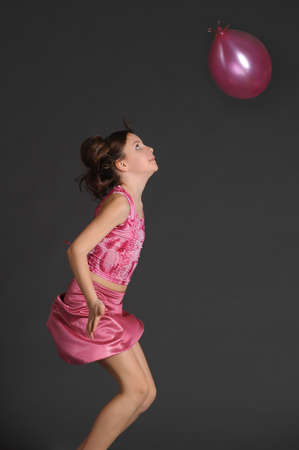 Girl in pink with pink ball photo
