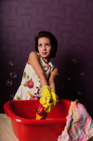 Girl wash clothes in a bucket Stock Photo - 9372330