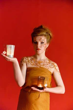 Portrait of a beautiful girl in orange dress photo