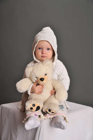 cuddly baby: baby and teddy bear