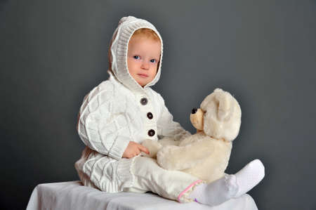embracement: baby and teddy bear