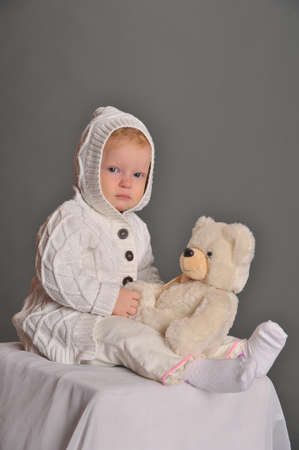 baby and teddy bear photo