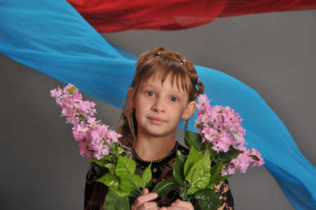 Girl with a branch of lilac in the hands photo