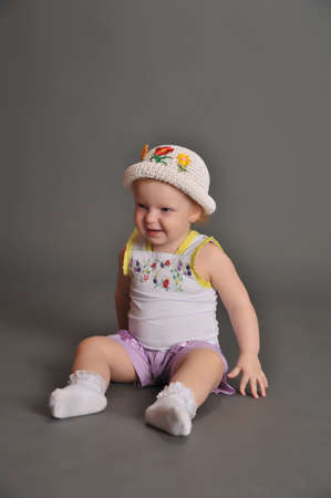 Cute baby girl in summer hat photo