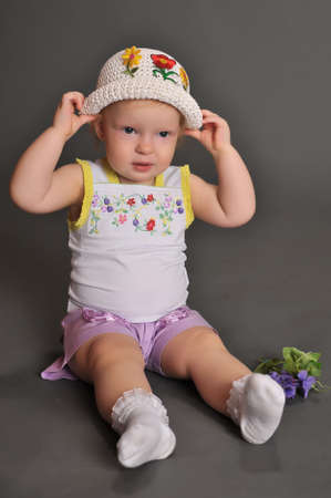 brown clothes: Cute baby girl in summer hat