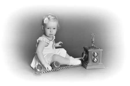 child and retro phone Stock Photo - 9381502