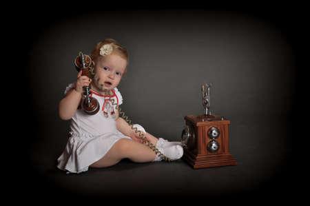 child and retro phone Stock Photo - 9381492