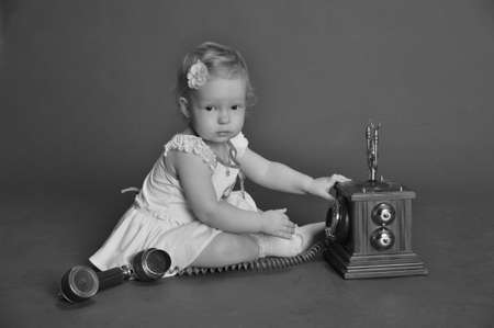 child and retro phone Stock Photo - 9381504