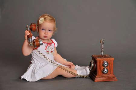 child and retro phone Stock Photo - 9381523
