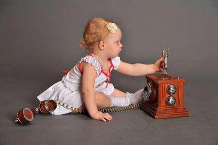 child and retro phone photo