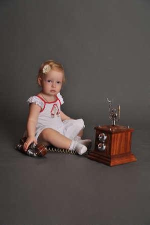 child and retro phone Stock Photo - 9381505