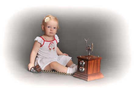 child and retro phone Stock Photo - 9381495